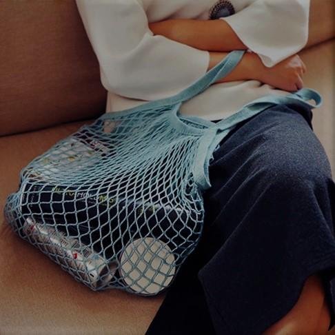 The Great Living Co. Blue Cotton Mesh Shopping Bag with short handles in Use