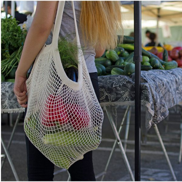 The Great Living Co. White Cotton Mesh Shopping Bag with long handles in Use